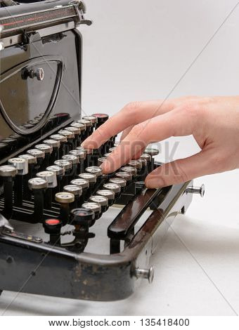 woman hand typing with old vintage typewriter