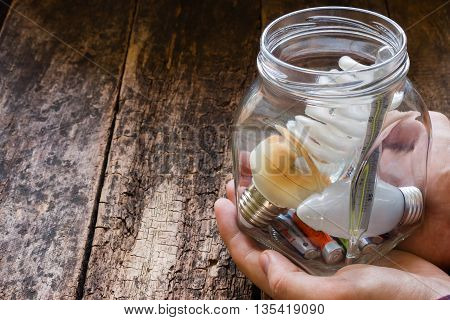 man holding a glass jar of hazardous waste