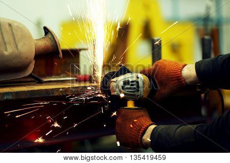 Man working with angle grinder