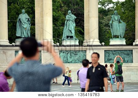 Budapest, HUNGARY - Jul 11, 2013. Tourists are taking pictures on Heroes' Square.