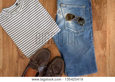 Top View Of Summer Vacations Clothes Isolated On Wooden Background