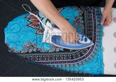Bright Picture Of Lovely Housewife With Iron , Flat Lay