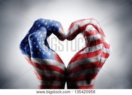 Love And Patriotism Symbols - Usa Flag On Hands