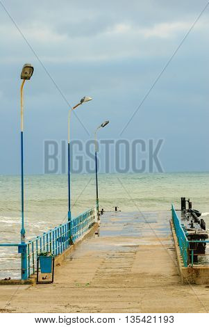 Wooden pier at the sea shore during winter