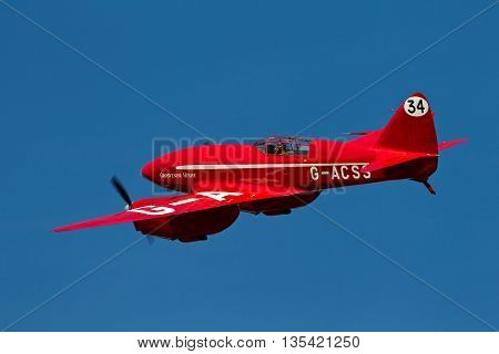 NORTHILL, UK - AUGUST 2: A DH88 Comet racing aircraft manoeuvres into position for landing at the Old Warden aerodrome on August 2, 2015 in Northill. The DH88 was first built in 1934 for £5K / unit