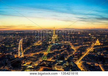 PARIS FRANCE - May 5 2016: Beautiful view Eiffel tower at dusk Paris France. Paris is capital city of France. Eiffel Tower is a wrought iron lattice tower on the Champ de Mars in Paris France.