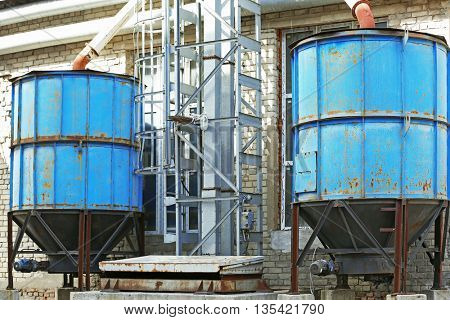 Old big blue tanks on the factory