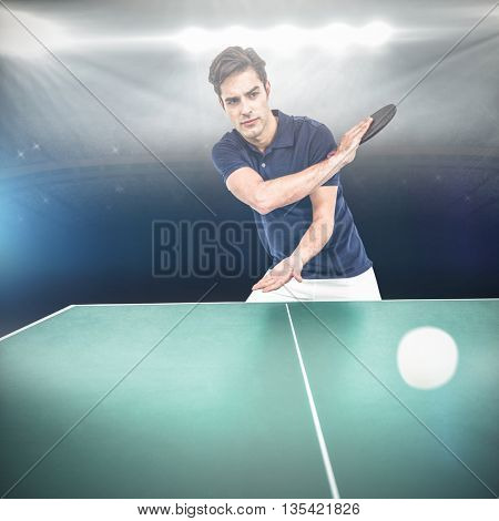 Confident male athlete playing table tennis