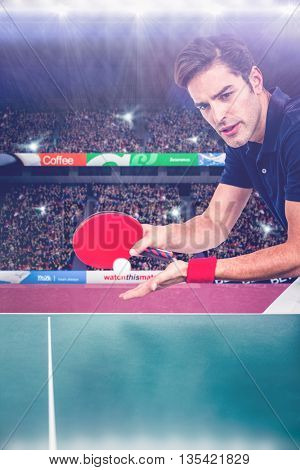 Confident male athlete playing table tennis against view of a stadium