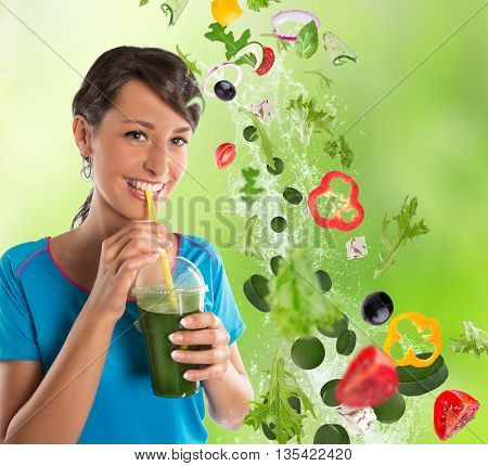 Green vegetable smoothie. Woman living healthy lifestyle drinking vegetable smoothies.