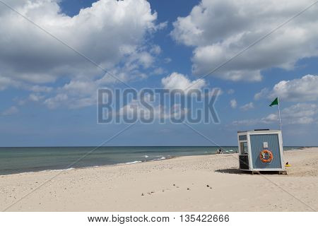 Tisvilde, Denmark - June 20, 2016: Wooden Lifeguard hut at Tisvilde beach.