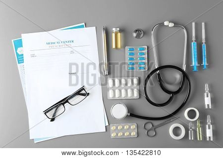 Doctor table with medical items. Flat lay