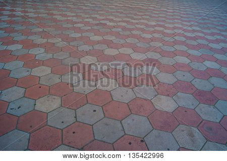 Path lined with burgundy tiles for background