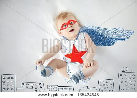 Little baby boy superhero