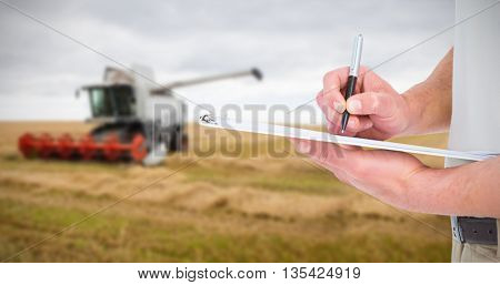 Delivery man writing on clipboard against white background with vignette