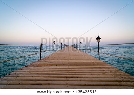 Tranquil wooden pier - quiet evening at Red Sea