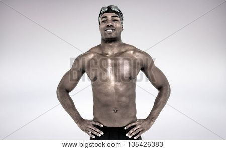 Swimmer smiling and posing against grey background