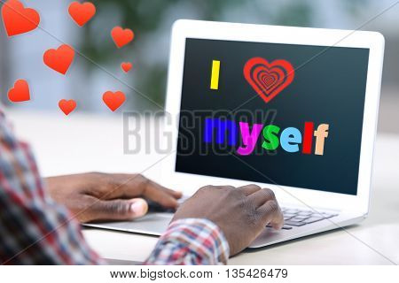 Love yourself concept. Businessman with laptop in his office, text I Love Myself on screen