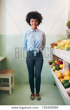 Happy Young African Woman Standing In A Juice Bar