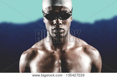 Swimmer ready to dive against blurred mountains