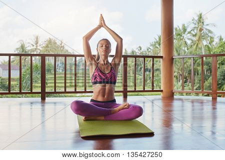 Fit Young Female Doing Yoga Workout