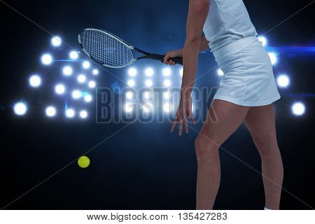 Athlete playing tennis with a racket against composite image of spotlight