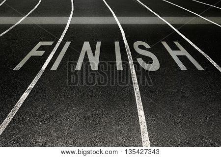 Finish written on running track