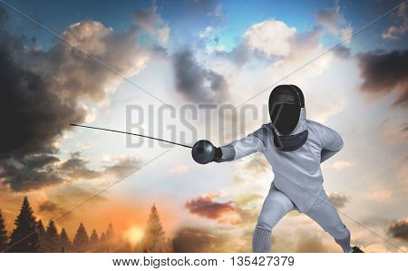 Man wearing fencing suit practicing with sword against country scene