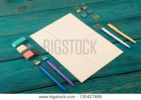 Blank Sheet Of Paper And Colorful Office Accessories