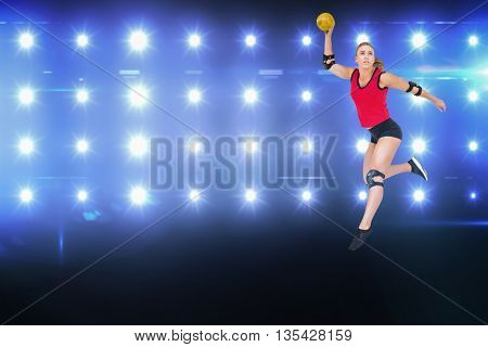 Female athlete with elbow pad throwing handball against composite image of blue spotlight