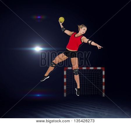 Female athlete with elbow pad throwing handball against view of lighting