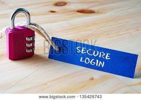 Words Secure Login Written On Tag Label Tied With A Padlock.
