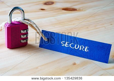 Words Secure Written On Tag Label Tied With A Padlock.