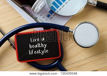 Medical Conceptual.stethoscope On Wooden Table With Word Live A Healthy Lifestyle.