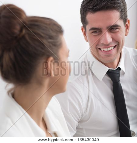 Businessman Flirting With Young Woman