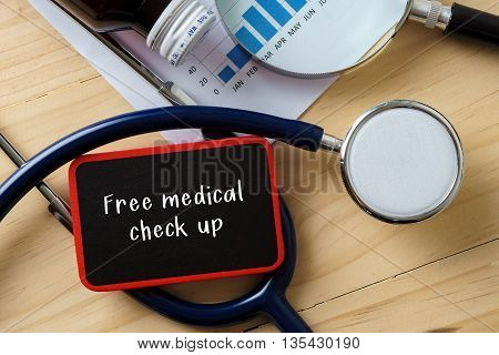Medical Conceptual.stethoscope On Wooden Table With Word Free Medical Check Up.