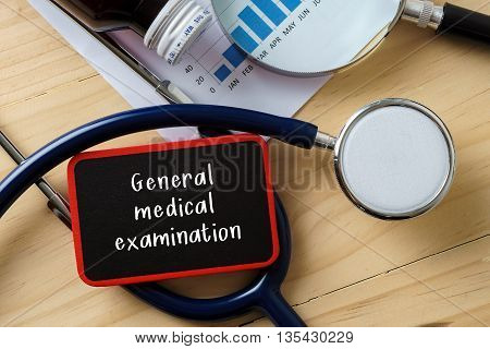Medical Conceptual.stethoscope On Wooden Table With Word General Medical Examination.