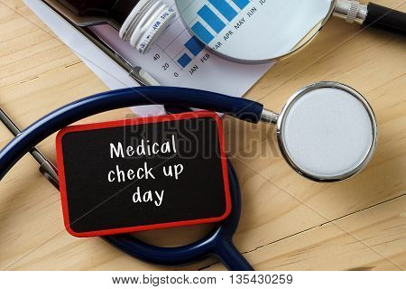 Medical Conceptual.stethoscope On Wooden Table With Word Medical Check Up Day.