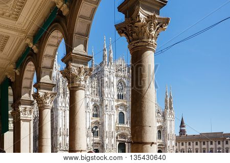 Milan Italy - May 04 2016: View of the Duomo Church through the columns of the Gallery Emanuele Vittorio