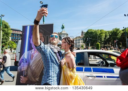 Milan Italy - May 04 2016: Couple of young people makes selfie during the parade of costumed Star Wars on the street of Luca Beltrami