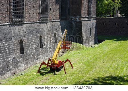 Milan Italy - May 04 2016: The crane near the wall of Sforza Castle famous historical attraction of the city spring time