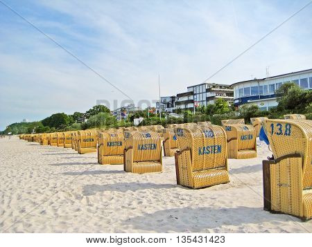 Scharbeutz Germany - May 23 2008: Beach in Scharbeutz with beach chairs along baltic sea coast hotels in the background