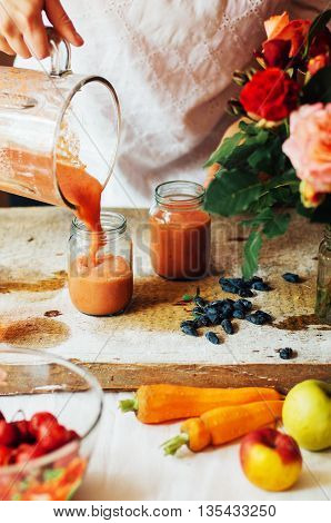 Hands Makes Strawberry Smoothies In Wooden Table . Fresh Strawbe