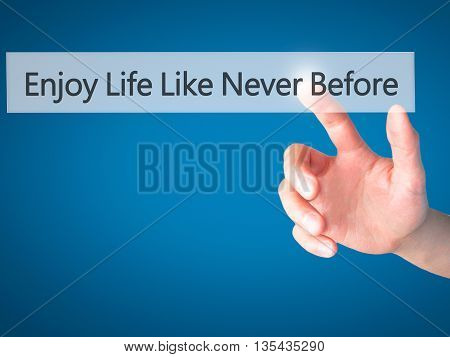 Enjoy Life Like Never Before - Hand Pressing A Button On Blurred Background Concept On Visual Screen