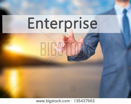Enterprise - Businessman Hand Pressing Button On Touch Screen Interface.