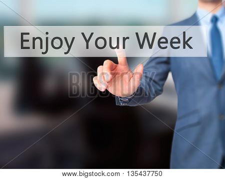 Enjoy Your Week - Businessman Hand Pressing Button On Touch Screen Interface.