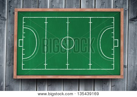 Handball field plan on a black background against blackboard with copy space on wooden board