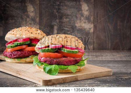 Veggie beet burgers on a rustic wooden table