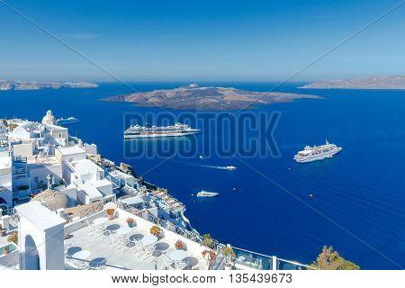 Passenger ships in the old port of Fira early sunny morning. Santorini. Greece.