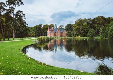 Bath House Hunting Lodge Reflected On Pond Near Frederiksborg Castle In Copenhagen, Denmark.